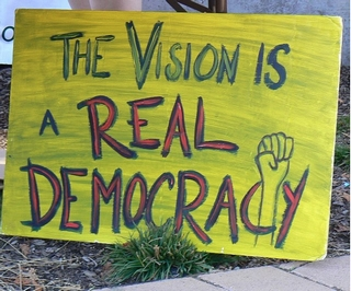 A sign saying the vision is a real democracy